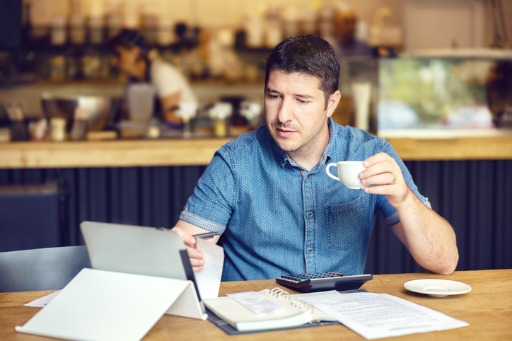business owner paying bills